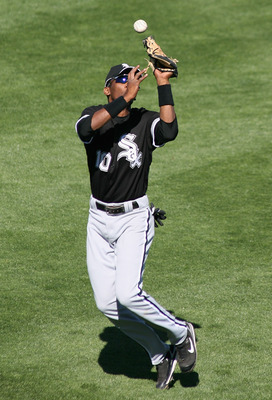 SURPRISE, AZ - MARCH 03:  Outfielder Alexi Ramirez #10 of the Chicago White Sox drops a fly ball for an error during the spring training game against the Kansas City Royals at Surprise Stadium March 3, 2008 in Surprise, Arizona.  (Photo by Christian Peter