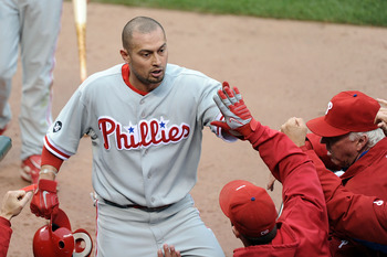 SAN FRANCISCO - OCTOBER 21:  Shane Victorino #8 of the Philadelphia Phillies celebrates in the dugout after scoring against the San Francisco Giants on a single by Placido Polanco #27 in the third inning of Game Five of the NLCS during the 2010 MLB Playof