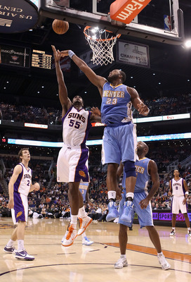 PHOENIX - OCTOBER 22:  Earl Clark #55 of the Phoenix Suns puts up a shot against Shelden Williams #23 of the Denver Nuggets during the preseason NBA game at US Airways Center on October 22, 2010 in Phoenix, Arizona. NOTE TO USER: User expressly acknowledg