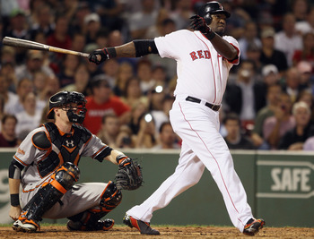 BOSTON - SEPTEMBER 22:  David Ortiz #34 of the Boston Red Sox hits a three run homer in the fourth inning as Matt Wieters #32 of the Baltimore Orioles defends on September 22, 2010 at Fenway Park in Boston, Massachusetts.  (Photo by Elsa/Getty Images)