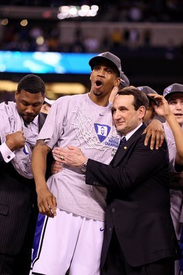 INDIANAPOLIS - APRIL 05:  Head coach Mike Krzyzewski and Lance Thomas of the Duke Blue Devils celebrate after they won 61-59 against the Butler Bulldogs during the 2010 NCAA Division I Men's Basketball National Championship game at Lucas Oil Stadium on Ap