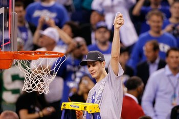 INDIANAPOLIS - APRIL 05:  Jon Scheyer of the Duke Blue Devils celebrates after he cut down a piece of the net following their 61-59 win against the Butler Bulldogs during the 2010 NCAA Division I Men's Basketball National Championship game at Lucas Oil St