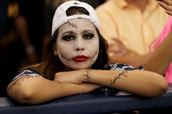 ARLINGTON, TX - OCTOBER 31:  A fan of the Dallas Cowboys looks on dejected against the Jacksonville Jaguars at Cowboys Stadium on October 31, 2010 in Arlington, Texas.  (Photo by Stephen Dunn/Getty Images)