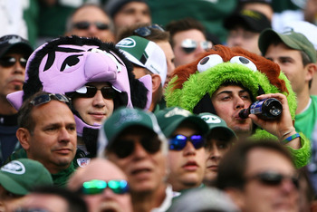 EAST RUTHERFORD, NJ - OCTOBER 31: Fans of the New York Jets dressed up as 'Oscar the Grouch' and 'The Count,' characters from the television show 'Sesame Street,' for the Jets game against the Green Bay Packers on October 31, 2010 at the New Meadowlands S