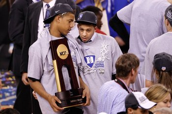 INDIANAPOLIS - APRIL 05:  (L-R) Andre Dawkins and Seth Curry of the Duke Blue Devils celebrate with the trophy after Duke won 61-59 against the Butler Bulldogs during the 2010 NCAA Division I Men's Basketball National Championship game at Lucas Oil Stadiu