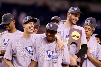 INDIANAPOLIS - APRIL 05:  (L-R) Jon Scheyer #30, Nolan Smith #2 and Brian Zoubek #55 of the Duke Blue Devils celebrate with the trophy after they won 61-59 against the Butler Bulldogs during the 2010 NCAA Division I Men's Basketball National Championship