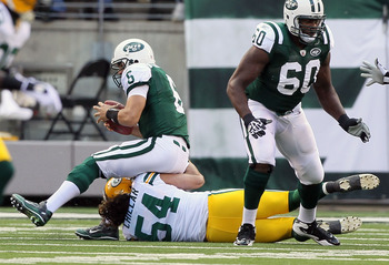 EAST RUTHERFORD, NJ - OCTOBER 31: Mark Sanchez #6 of the New York Jets is sacked by Brandon Chillar #54 of the Green Bay Packers on October 31, 2010 at the New Meadowlands Stadium in East Rutherford, New Jersey. The Packers defeated the Jets 9-0. (Photo b