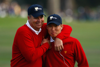 SAN FRANCISCO - OCTOBER 08:  (L-R)  Kenny Perry and Anthony Kim of the USA Team celebrate in the 18th fairway during the Day One Foursome Matches of The Presidents Cup at Harding Park Golf Course on October 8, 2009 in San Francisco, California.  (Photo by