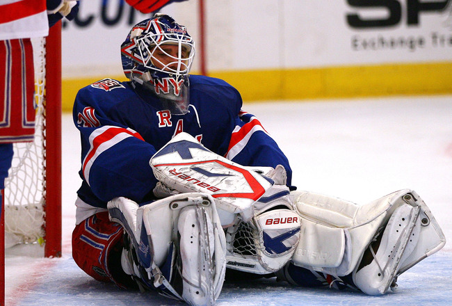 NEW YORK - OCTOBER 29:  Henrik Lundqvist #30 of the New York Rangers sits on the ice after allowing Erik Cole, of the Carolina Hurricanes, to score the game-winning goal in the third period on October 29, 2010 at Madison Square Garden in New York City, Ne