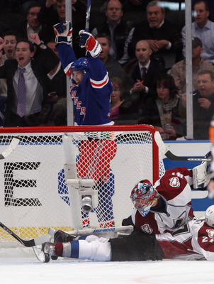 NEW YORK - OCTOBER 18: Alex Frolov #31 of the New York Rangers celebrates his first goal of the season at 18:09 of the first period against Craig Anderson #41 of the Colorado Avalanche at Madison Square Garden on October 18, 2010 in New York City.  (Photo