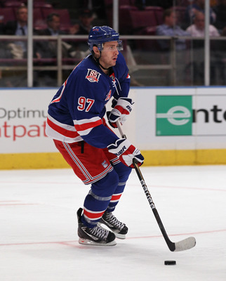 NEW YORK - OCTOBER 18:  Matt Gilroy #97 of the New York Rangers skates against the Colorado Avalanche at Madison Square Garden on October 18, 2010 in New York City. The Avalanche defeated the Rangers 3-1.  (Photo by Bruce Bennett/Getty Images)