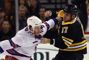 BOSTON - OCTOBER 23: Brandon Prust #8 of the New York Rangers and Milan Lucic #17 of the Boston Bruins fight during the first period at the TD Garden on October 23, 2010 in Boston, Massachusetts.  (Photo by Bruce Bennett/Getty Images)