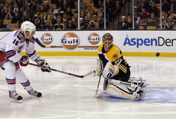 BOSTON - OCTOBER 23: Marc Staal #18 of the New York Rangers scores a  breakaway goal at 48 seconds of the second period against Tuukka Rask #40 of the Boston Bruins at the TD Garden on October 23, 2010 in Boston, Massachusetts.  (Photo by Bruce Bennett/Ge
