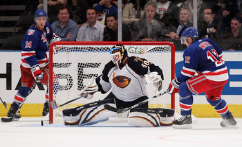 NEW YORK - OCTOBER 27:  Chris Mason #50 of the Atlanta Thrashers makes a save as Todd White #12 and Ryan Callahan #24 of the New York Rangers look for the rebound on October 27, 2010 at Madison Square Garden in New York City.  (Photo by Jim McIsaac/Getty