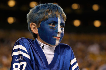 GREEN BAY, WI - AUGUST 26: A young fan of the Indianapolis Colts watches as his team takes on the Green Bay Packers during a preseason game at Lambeau Field on August 26, 2010 in Green Bay, Wisconsin. The Packers defeated the Colts 59-24.  (Photo by Jonat