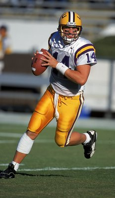 23 Oct 1999:  Josh Booty #14 of the LSU Tigers moves with the ball during the game against the Mississippi State Bulldogs at the Scott Stadium in Starkville, Mississippi. The Bulldogs defeated the Tigers 17-16. Mandatory Credit: Scott Halleran  /Allsport