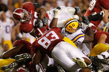 BATON ROUGE, LA - NOVEMBER 08:  Glen Coffee #38 of the Alabama Crimson Tide jumps over Kelvin Sheppard #11 of the Louisiana State University Tigers on November 11, 2008 at Tiger Stadium in Baton Rouge, Louisiana. The Tide defeated the Tigers 27-21 in over