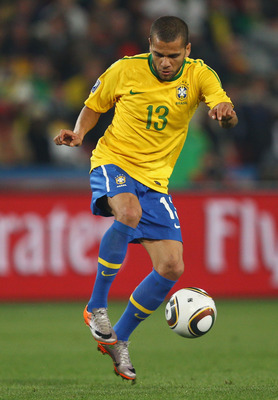JOHANNESBURG, SOUTH AFRICA - JUNE 28:  Dani Alves of Brazil controls the ball during the 2010 FIFA World Cup South Africa Round of Sixteen match between Brazil and Chile at Ellis Park Stadium on June 28, 2010 in Johannesburg, South Africa.  (Photo by Rich