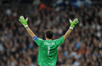 MADRID, SPAIN - OCTOBER 19:  Iker Casillas of Real Madrid urges on his side during the UEFA Champions League Group G match between Real Madrid and AC Milan at Estadio Santiago Bernabeu on October 19, 2010 in Madrid, Spain.  (Photo by Denis Doyle/Getty Ima