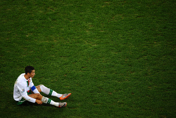 CAPE TOWN, SOUTH AFRICA - JUNE 29:  Dejected Cristiano Ronaldo of Portugal after his side is knocked out of the tournament during the 2010 FIFA World Cup South Africa Round of Sixteen match between Spain and Portugal at Green Point Stadium on June 29, 201