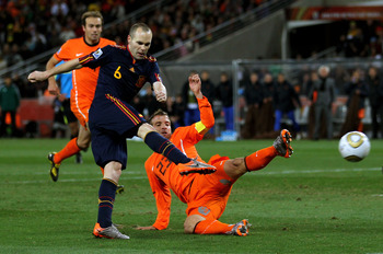 JOHANNESBURG, SOUTH AFRICA - JULY 11:  Andres Iniesta of Spain scores his side's first goal during the 2010 FIFA World Cup South Africa Final match between Netherlands and Spain at Soccer City Stadium on July 11, 2010 in Johannesburg, South Africa.  (Phot