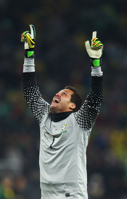 JOHANNESBURG, SOUTH AFRICA - JUNE 20:  Julio Cesar of Brazil celebrates victory in the 2010 FIFA World Cup South Africa Group G match between Brazil and Ivory Coast at Soccer City Stadium on June 20, 2010 in Johannesburg, South Africa.  (Photo by Richard