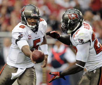 GLENDALE, AZ - OCTOBER 31:  Josh Freeman #5 of the Tampa Bay Buccaneers hands off to LeGarrette Blount #27 against the Arizona Cardinals during the third quarter at University of Phoenix Stadium on October 31, 2010 in Glendale, Arizona.  (Photo by Harry H