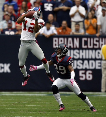 HOUSTON - OCTOBER 10:  Wide receiver Steve Smith #12 of the New York Giants goes up high in front of cornerback Glover Quin #29 of the Houston Texans in the first half at Reliant Stadium on October 10, 2010 in Houston, Texas.  (Photo by Bob Levey/Getty Im