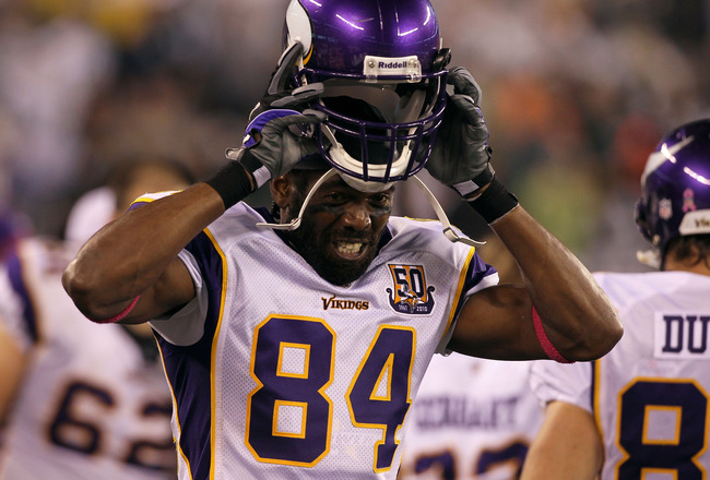 EAST RUTHERFORD, NJ - OCTOBER 11:  Randy Moss #84 of the Minnesota Vikings adjusts his helmet against the New York Jets at New Meadowlands Stadium on October 11, 2010 in East Rutherford, New Jersey. The Jets won 29-20.  (Photo by Jim McIsaac/Getty Images)