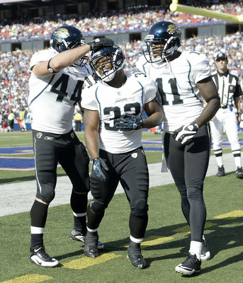 ORCHARD PARK, NY - OCTOBER 10: Brock Bolen #44, Maurice Jones-Drew #32 and Mike Sims-Walker #11  of the Jacksonville Jaguars celebrate Jones-Drew run for a touchdown that was called back for a penalty against the Buffalo Bills   at Ralph Wilson Stadium on