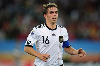 DURBAN, SOUTH AFRICA - JULY 07:  Captain Philipp Lahm of Germany looks on during the 2010 FIFA World Cup South Africa Semi Final match between Germany and Spain at Durban Stadium on July 7, 2010 in Durban, South Africa.  (Photo by Clive Mason/Getty Images
