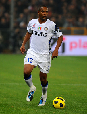 GENOA, ITALY - OCTOBER 29: Sisenando Maicon Douglas of FC Internazionale Milano runs with the ball  during the Serie A match between Genoa CFC and FC Inter Milan at Stadio Luigi Ferraris on October 29, 2010 in Genoa, Italy. (Photo by Massimo Cebrelli/Gett