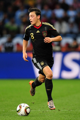 CAPE TOWN, SOUTH AFRICA - JULY 03: Mesut Oezil of Germany in action during the 2010 FIFA World Cup South Africa Quarter Final match between Argentina and Germany at Green Point Stadium on July 3, 2010 in Cape Town, South Africa.  (Photo by Clive Mason/Get