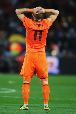 JOHANNESBURG, SOUTH AFRICA - JULY 11:  Arjen Robben of the Netherlands shows his dejection at the final whistle after losing the 2010 FIFA World Cup South Africa Final match between Netherlands and Spain at Soccer City Stadium on July 11, 2010 in Johannes