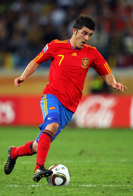 DURBAN, SOUTH AFRICA - JULY 07:  David Villa of Spain runs with the ball during the 2010 FIFA World Cup South Africa Semi Final match between Germany and Spain at Durban Stadium on July 7, 2010 in Durban, South Africa.  (Photo by Cameron Spencer/Getty Ima