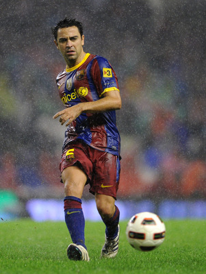 BILBAO, SPAIN - SEPTEMBER 25:  Xavi Hernandez of Barcelona passes the ball during the La Liga match between Athletic Bilbao and Barcelona at the San Mames Stadium on September 25, 2010 in Bilbao, Spain. Barcelona won the match 3-1.  (Photo by Jasper Juine