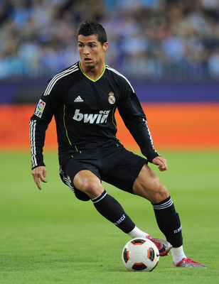 MALAGA, SPAIN - OCTOBER 16: Cristiano Ronaldo of Real Madrid dribbles during the La Liga match between Malaga and Real Madrid at La Rosaleda Stadium on October 16, 2010 in Malaga, Spain.  (Photo by Denis Doyle/Getty Images)