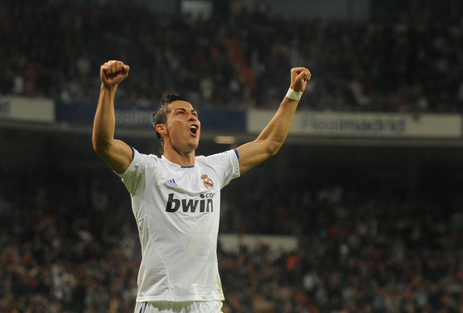 MADRID, SPAIN - OCTOBER 23:  Cristiano Ronaldo of Real Madrid celebrates after scoring Real's 4th goal during the La Liga match between Real Madrid and Racing Santander at Estadio Santiago Bernabeu on October 23, 2010 in Madrid, Spain.  (Photo by Denis Do