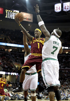 CLEVELAND - OCTOBER 27: Daniel Gibson #1 of the Cleveland Cavaliers tries to get a shot off around Jermaine O'Neal #7 of the Boston Celtics at Quicken Loans Arena on October 27, 2010 in Cleveland, Ohio. Cleveland won the game 95-87.  (Photo by Gregory Sha
