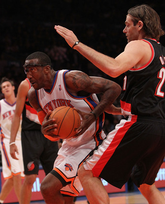 NEW YORK - OCTOBER 30:  Amar'e Stoudemire #1 of the New York Knicks drives against Fabricio Oberto #21 of the Portland Trail Blazers at Madison Square Garden on October 30, 2010 in New York City. NOTE TO USER: User expressly acknowledges and agrees that,