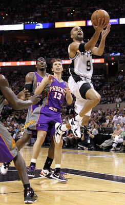 SAN ANTONIO - MAY 09:  Guard Tony Parker #9 of the San Antonio Spurs takes a shot against Steve Nash #13 of the Phoenix Suns in Game Four of the Western Conference Semifinals during the 2010 NBA Playoffs at AT&T Center on May 9, 2010 in San Antonio, Texas