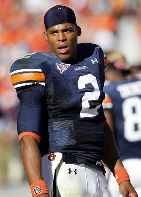AUBURN, AL - OCTOBER 16:  Quarterback Cam Newton #2 of the Auburn Tigers walks on the sideline during the game against the Arkansas Razorbacks at Jordan-Hare Stadium on October 16, 2010 in Auburn, Alabama.  (Photo by Mike Zarrilli/Getty Images)