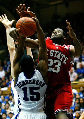 DURHAM, NC - JANUARY 20:  Tracy Smith #23 of the North Carolina State Wolfpack draws a foul from Gerald Henderson #15 of the Duke Blue Devils during the game on January 20, 2009 at Cameron Indoor Stadium in Durham, North Carolina.  (Photo by Kevin C. Cox/