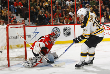 OTTAWA, ON - OCTOBER 30:  Jordan Carron #38 of the Boston Bruins scores a breakaway goal on Brian Elliott #30 of the Ottawa Senators during a game at Scotiabank Place on October 30, 2010 in Ottawa, Ontario, Canada.  The Boston Bruins defeated the Ottawa S