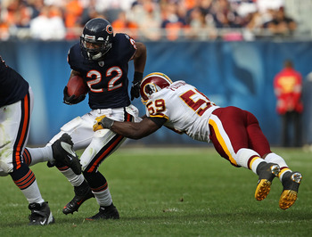 CHICAGO - OCTOBER 24: Matt Forte #22 of the Chicago Bears avoids a tackle attempt by London Fletcher #59 of the Washington Redskins at Soldier Field on October 24, 2010 in Chicago, Illinois. The Redskins defeated the Bears 17-14. (Photo by Jonathan Daniel