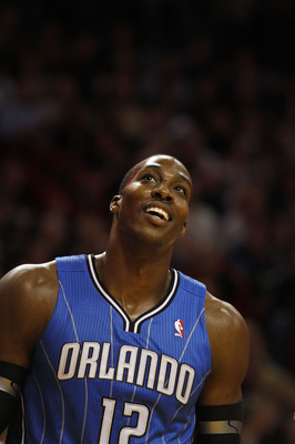 MIAMI - OCTOBER 29:  Center Dwight Howard #12  of the Orlando Magic dunks against the Miami Heat at American Airlines Arena on October 29, 2010 in Miami, Florida.  NOTE TO USER: User expressly acknowledges and agrees that, by downloading and or using this