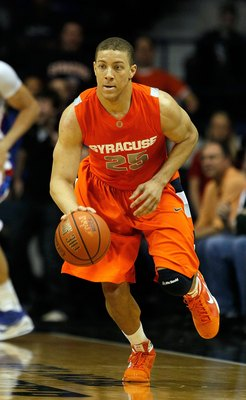 ROSEMONT, IL - JANUARY 30: Brandon Triche #25 of the Syracuse Orange brings the ball up court against the DePaul Blue Demons at the Allstate Arena on January 30, 2010 in Rosemont, Illinois. Syracuse defeated DePaul 59-57. (Photo by Jonathan Daniel/Getty I