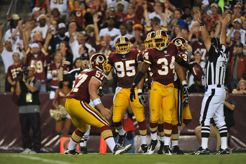 LANDOVER - SEPTEMBER 12:  Byron Westbrook #34 of the Washington Redskins celebrates downing the ball at the one yard line during the NFL season opener against the Dallas Cowboys at FedExField on September 12, 2010 in Landover, Maryland. The Redskins defea