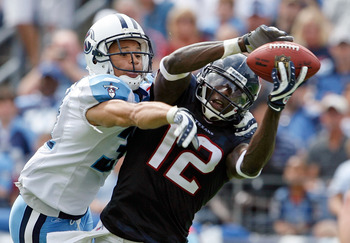 NASHVILLE, TN - SEPTEMBER 20:  Jacoby Jones #12 of the Houston Texans catches a touchdown pass while defended by Cortland Finnegan #31 of the Tennessee Titans during the  NFL game at LP Field on September 20, 2009 in Nashville, Tennessee. The Texans won 3