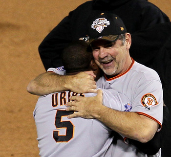 ARLINGTON, TX - NOVEMBER 01:  Manager Bruce Bochy of the San Francisco Giants celebrates with Juan Urbie #5 after the Giants won 3-1 against the Texas Rangers in Game Five of the 2010 MLB World Series at Rangers Ballpark in Arlington on November 1, 2010 i